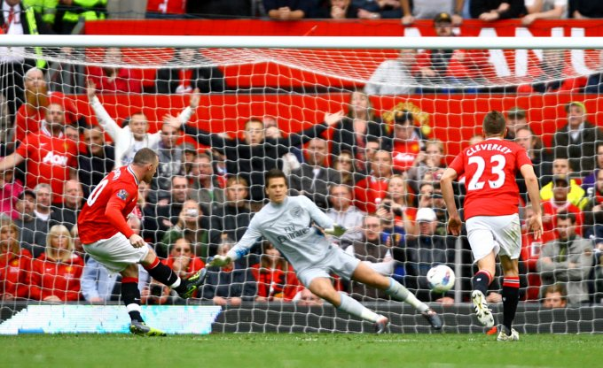 Manchester United's Wayne Rooney scores his third, and his side's seventh, goal of the match
