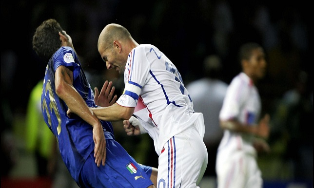 Amsterdam, NETHERLANDS: A picture taken 09 July 2006 shows France's captain Zinedine Zidane (R) headbutting Italy's defender Marco Materazzi 09 July 2006 during the football World Cup final in Berlin. The picture taken by Peter Schols of the Reuters news agency won 09 February 2007 the first prize in the Sports Action Stories category of the World Press Photo of the Year 2006 in Amsterdam. AFP PHOTO / Dagblad De Limburger/ GPD /Reuters / PETER SCHOLS *** IMPORTANT NOTICE *** This material is for single publications in print or for a temporary online publication, and may be used exclusively to publicize the 2007 World Press Photo contest and exhibition. It may not be published as part of an article or any other item that contains no direct link to World Press Photo and its activities. Nor may it be sold. The pictures may not be cropped or manipulated in any way. World Press Photo cannot authorize any other publication of the material. All other requests need to be addressed to the individual photographers and their official representatives. World Press Photo will be happy to provide you with any relevant information upon request. Publication must always be accompanied by the appropriate credit: NAME PHOTOGRAPHER, AGENCY / ORIGINAL PUBLICATION After publication the files must be deleted from your archive. Please send us a copy of the published article or let us know when you have published your article online for our press archive. (Photo credit should read Peter Schols/AFP/Getty Images)