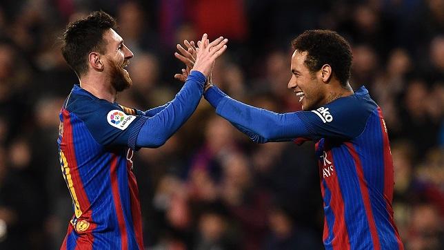 الأرجنتيني ليونيل ميسي لاعب فريق برشلونة الإسباني مع زميله البرازيلي نيمار