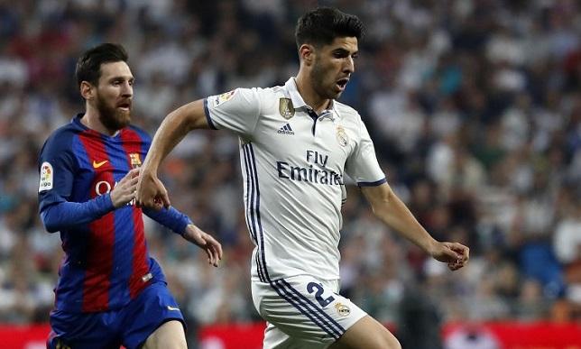 ماركو أسينسيو بقميص ريال مدريد يواجه ليونيل ميسي بقميص  برشلونة