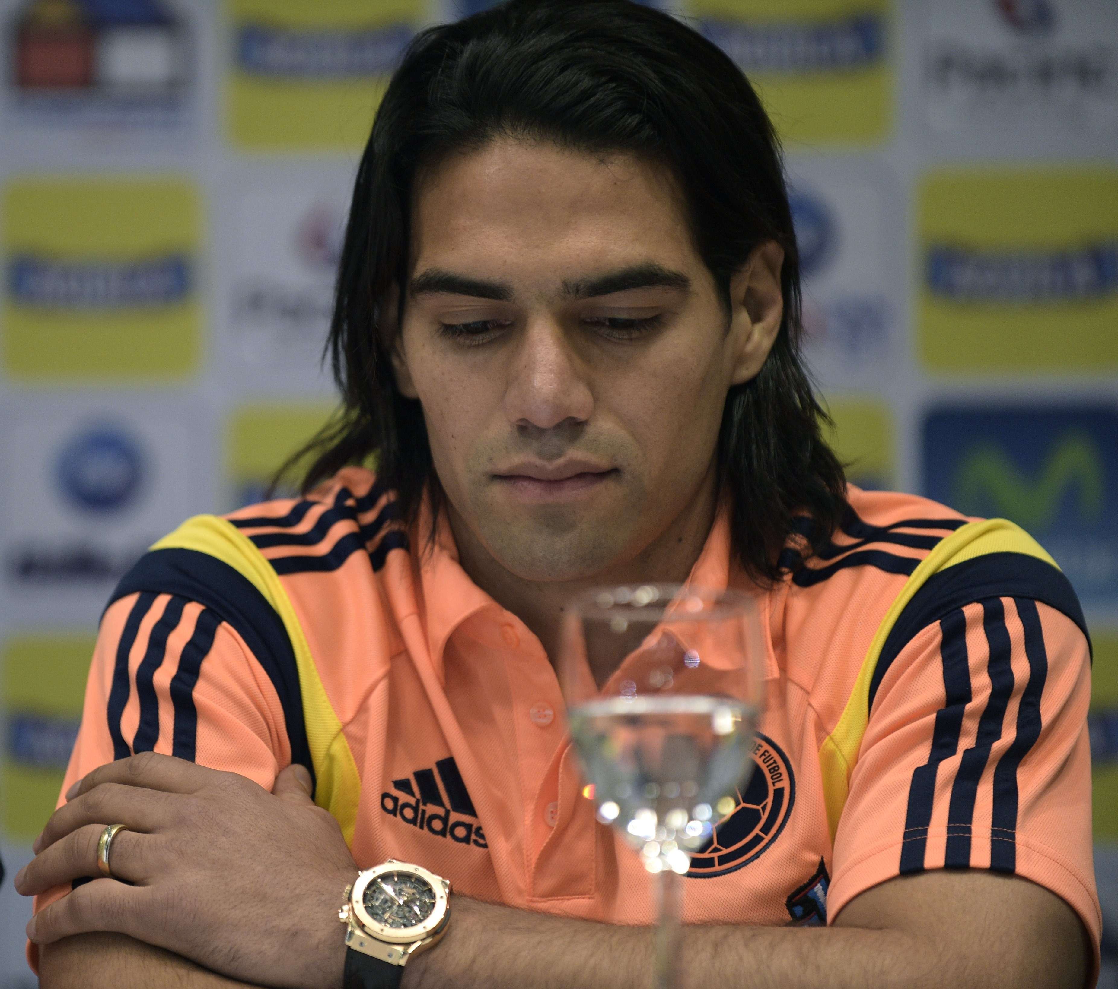 Colombia's national forward Radamel Falcao Garcia gestures during the press conference where coach Jose Pekerman (not in frame) announced that Amaranto Perea, Luis Muriel and himself will be out of the list of 23 players for the FIFA World Cup, in Cardales, on June 2, 2014.   AFP PHOTO / DANIEL GARCIA        (Photo credit should read DANIEL GARCIA/AFP/Getty Images)