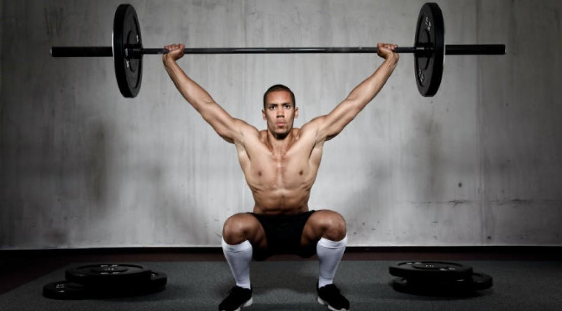 تمارين القرفصاء مع رفع الوزن