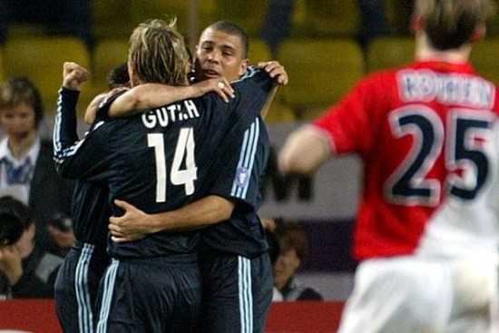 REAL-MADRID-PLAYERS-RONALDO-AND-GUTI-CELEBRATE-GOAL-BY-RAUL-AS-MONACOS-ROTHEN-LOOKS-ON-DURING-THEIR