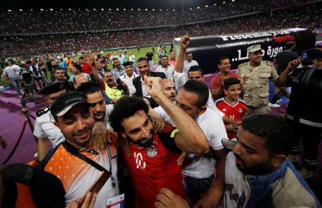 egypt_striker_mohammed_salah_is_mobbed_by_fans_after_he_sealed_his_countrys_qualification_for_the_2018_world_cup._reuters