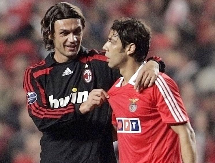 Benfica's Rui Costa talks with AC Milan's Maldini at the end of their Champions League match in Lisbon