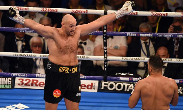TOPSHOT - Britain's Tyson Fury (L) and Albania's Sefer Seferi goad each other during their heavyweight contest at the Manchester Arena in Manchester, northern England on June 9, 2018. Tyson Fury made a winning comeback to boxing after more than two-and-a-half years out of the ring after opponent Sefer Seferi quit on his stool at the end of four rounds. Former heavyweight champion Fury had not fought since dethroning Ukrainian Wladimir Klitschko in 2015 and suffered various drug, alcohol and mental health issues since then. / AFP PHOTO / OLI SCARFFOLI SCARFF/AFP/Getty Images