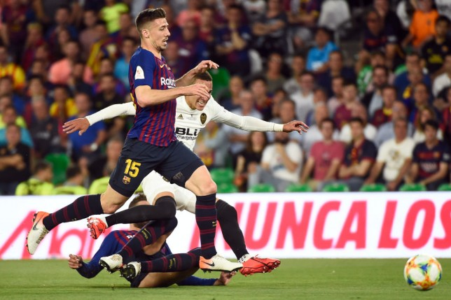 Valencia's Spanish forward Rodrigo Moreno (C) vies with Barcelona's French defender Clement Lenglet (TOP) and Barcelona's Spanish defender Gerard Pique during the 2019 Spanish Copa del Rey (King's Cup) final football match between Barcelona and Valencia on May 25, 2019 at the Benito Villamarin stadium in Sevilla. (Photo by JOSE JORDAN / AFP)        (Photo credit should read JOSE JORDAN/AFP/Getty Images)