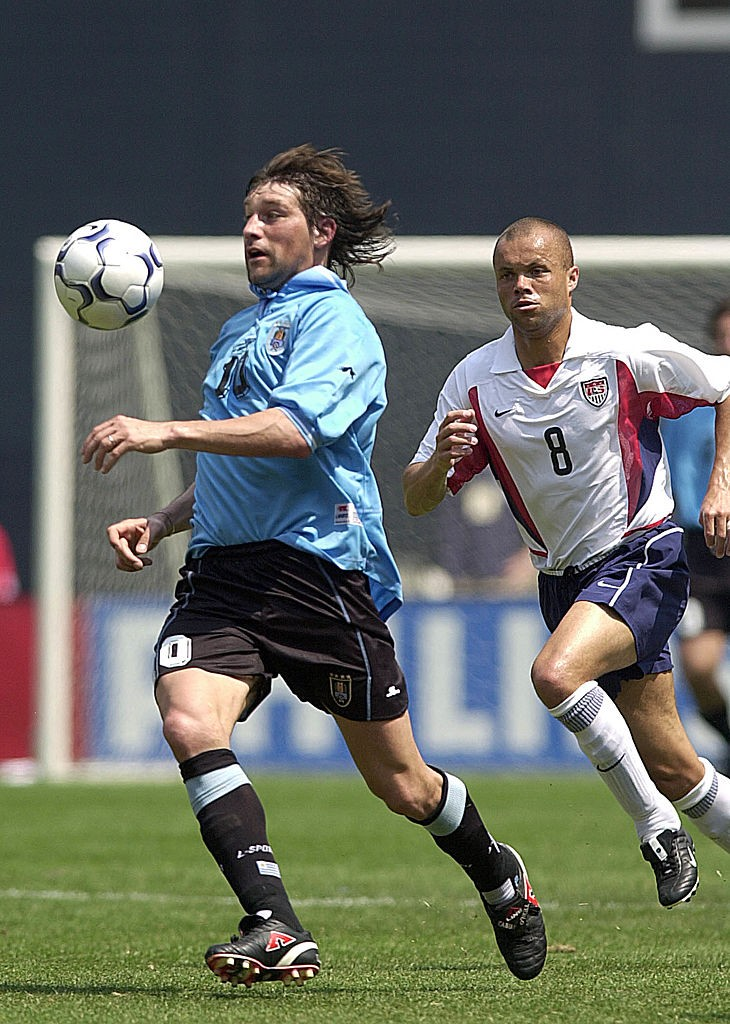 Fabian O'Neill of Uruguay (L) takes control of the
