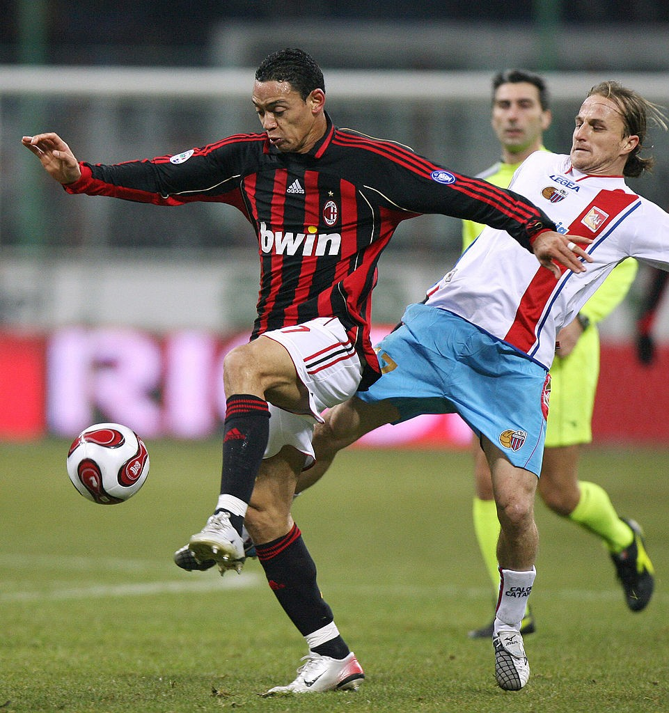 AC Milan's forward Ricardo Olivera fight