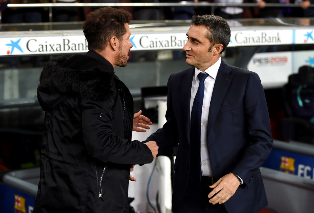 BARCELONA, SPAIN - APRIL 06: Diego Simeone, Manager of Atletico Madrid shakes hands with Ernesto Valverde, Manager of Barcelona prior to the La Liga match between FC Barcelona and Club Atletico de Madrid at Camp Nou on April 06, 2019 in Barcelona, Spain. (Photo by Alex Caparros/Getty Images)
