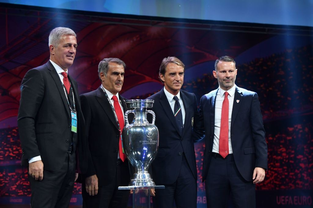 Coaches from Group A teams pose behind the trophy during the UEFA Euro 2020 football competition final draw in Bucharest on November 30, 2019 (L-R): head coach of Switzerland Vladimir Petkovic, head coach of Turkey Senol Gunes, head coach of Italy Roberto Mancini and head coach of Wales Ryan Giggs. (Photo by Daniel MIHAILESCU / AFP) (Photo by DANIEL MIHAILESCU/AFP via Getty Images)