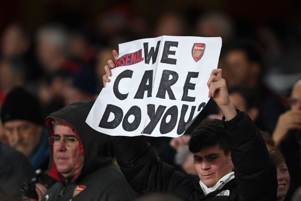 LONDON, ENGLAND - NOVEMBER 28: An Arsenal fan holds a sign saying 'We care do you?' during the UEFA Europa League group F match between Arsenal FC and Eintracht Frankfurt at Emirates Stadium on November 28, 2019 in London, United Kingdom. (Photo by Mike Hewitt/Getty Images)