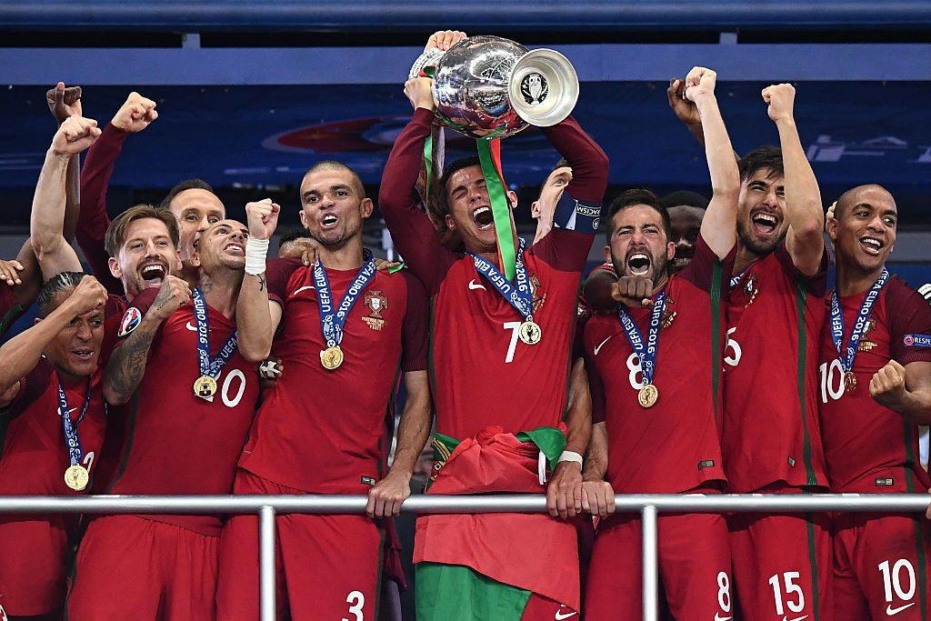 TOPSHOT - Portugal's captain and forward Cristiano Ronaldo hold up the winners' trophy in the Euro 2016 final football match between France and Portugal at the Stade de France in Saint-Denis, north of Paris, on July 10, 2016. Portugal beat France 1-0. / AFP / FRANCK FIFE (Photo credit should read FRANCK FIFE/AFP via Getty Images)
